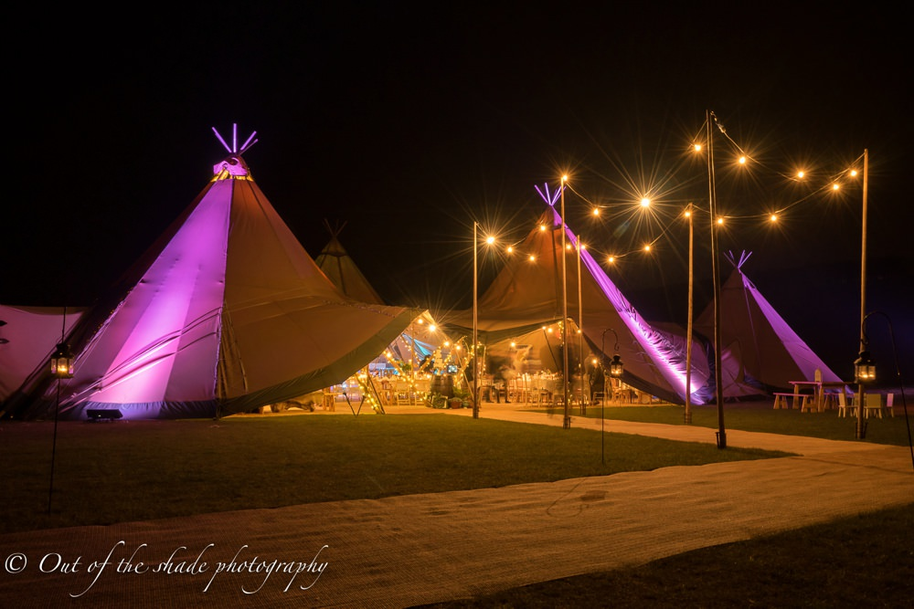 All About Me Tipi lit up at night