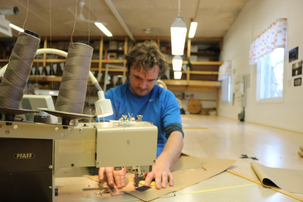 James sewing at the Tentipi Factory
