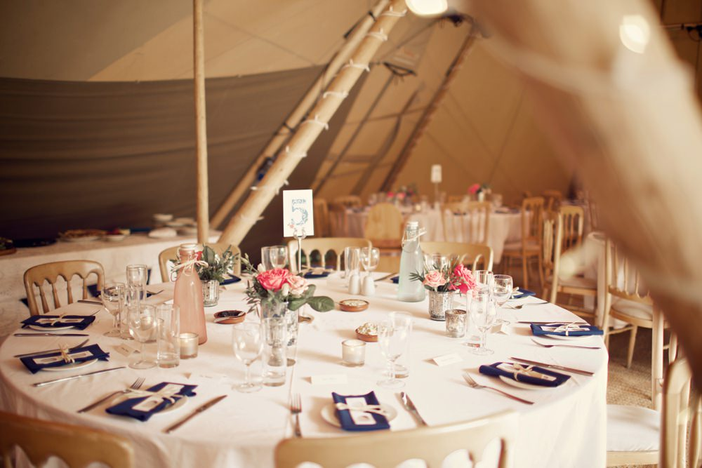 tables set for wedding breakfast in tipi
