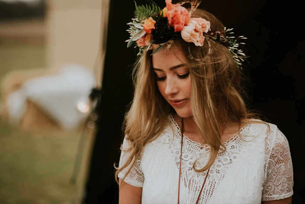 Flower crown bride outside tipi