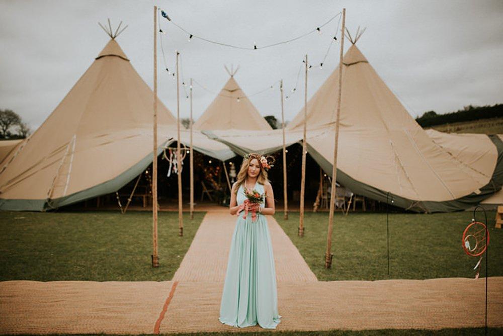 Boho bride and tipi