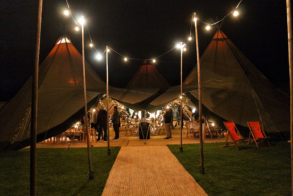Christmas party time - tipi entrance with twinkly lights