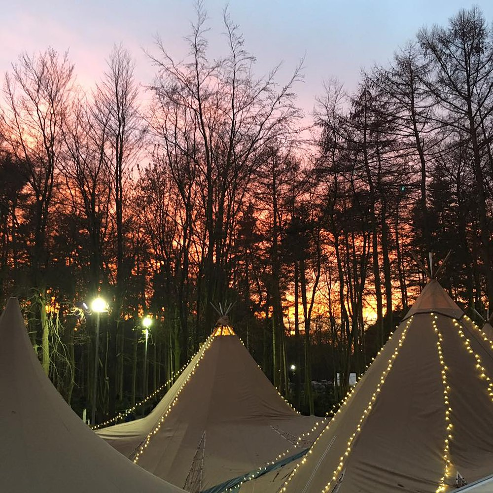 Tipi strung with Christmas lights