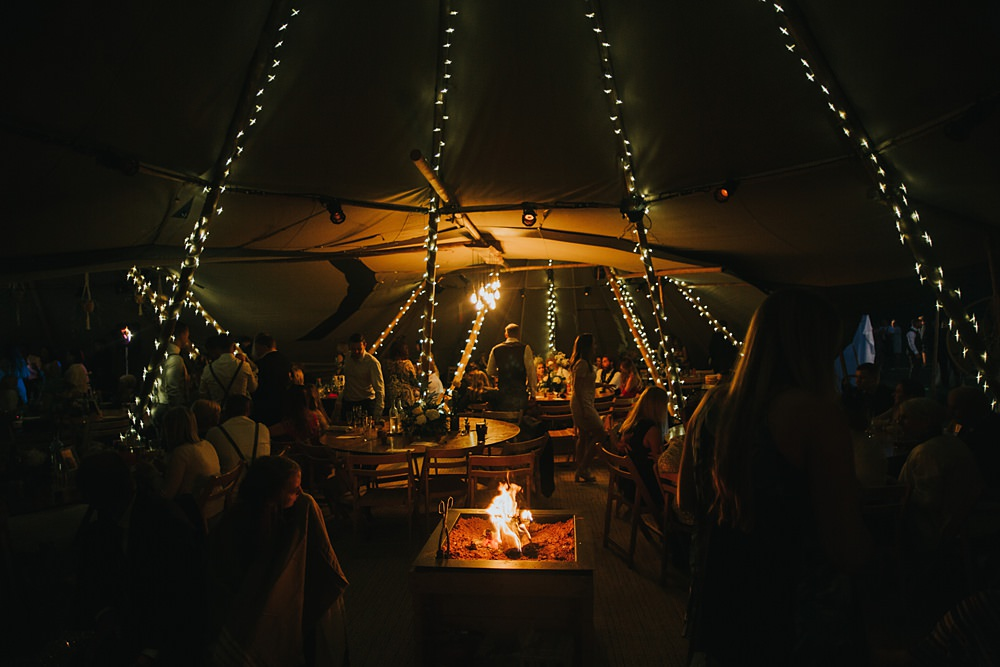 NIght time in boho wedding tipi